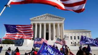 Demonstrators protest outside the Supreme Court on Tuesday