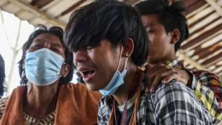 Mourners at the funeral of teenager Tun Tun Aung, who was killed in Mandalay, Myanmar