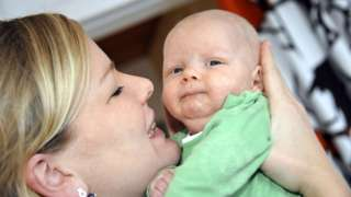 Mother holds baby in Helsinki (file pic)