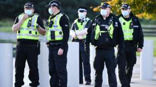 Five police officers with masks