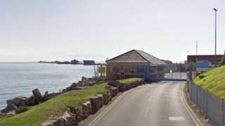 Gates to former Qinetiq site at Newtons Cove in Weymouth