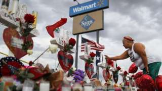 People pay their respects at Walmart, El Paso