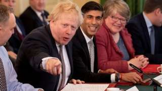 Boris Johnson addressing his new cabinet, with Chancellor Rishi Sunak sitting on his right