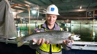 Johan Andreassen holding a salmon