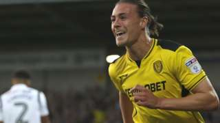 Burton's Jackson Irvine scores against Derby County