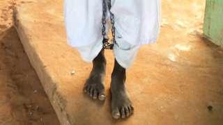 Boy in chains