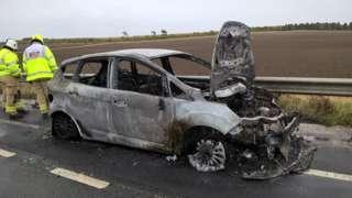 Burnt car on A34