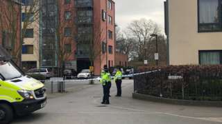 Police activity outside a block of flats on Union Lane, Isleworth