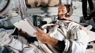 Command Module pilot Michael Collins practices in the CM simulator at the Kennedy Space Centre ahead of the Apollo 11 moon landing mission