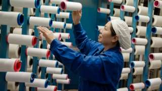 This photo taken on February 22, 2018 shows a woman working at a textile factory in Haian in China's eastern Jiangsu province