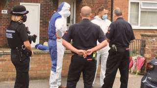 Forensic investigators outside a flat in Gorleston where a man and woman have been found dead