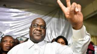 Felix Tshisekedi holds two fingers up in a victory sign