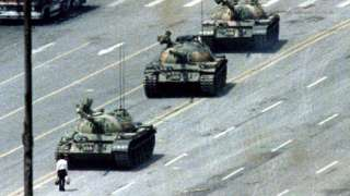Tank man, an unknown person famously pictured standing before tanks in Tiananmen Square in 1989