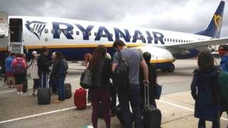 Passengers boarding a Ryanair aeroplane
