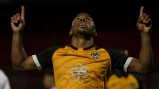 Tristan Abrahams celebrates after scoring from the spot
