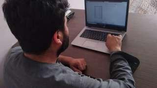 Habib with his laptop