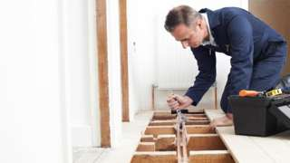 A stock image of a plumber