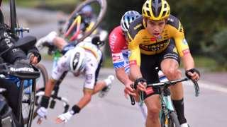 Julian Alaphilippe(back left) crashes behind Wout van Aert and Mathieu van der Poel