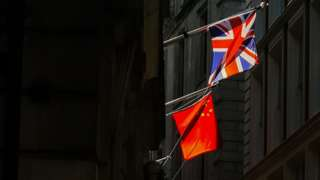 The Union flag and Chinese flag hang together in the City of London