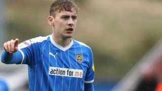 Elliott Hewitt in action for Notts County