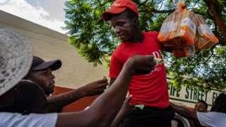 Zimbabweans jostle to buy bread
