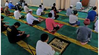 Muslims pray while practicing social distancing inside a mosque amid the spread of the coronavirus disease in Temanggung, Central Java province, Indonesia
