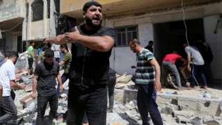 Palestinian man react for di scene wia Israeli strike hit one house for southern Gaza Strip May 12, 2021