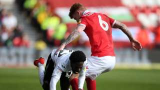 Nathan Dyer of Swansea City is tackled by Jack Colback of Nottingham Forest
