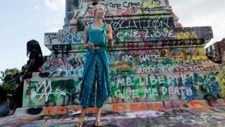 Graffiti covers a confederate statue