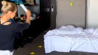 Tennis player Yulia Putintseva of Kazakhstan hitting a tennis ball in her hotel room during coronavirus quarantine
