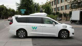 A Waymo self-driving car pulls into a parking lot at the Google-owned company's headquarters in Mountain View, California, on May 8, 2019.