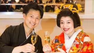 Jeff and Mizuki Hsu wearing traditional outfits