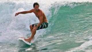 Jon Lewin surfing