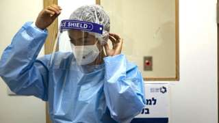 Health worker in full PPE