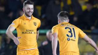 Livingston's Craig Halkett (left) celebrates his goal to make it 1-0.