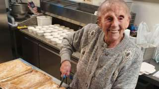 Flo Osborne cutting up the pies she had made for the elderly and vulnerable