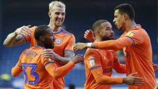 Junior Hoilett celebrates with Cardiff team mates
