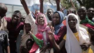 Sudanese men and women celebrate outside the Friendship Hall in the capital Khartoum where generals and protest leaders signed a historic transitional constitution meant to pave the way for civilian rule in Sudan, on August 17, 2019