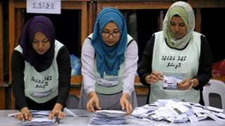 Maldives election commission officials prepare ballot papers for counting votes at a polling station at the end of the presidential election day in Male, Maldives on 23 September 2018.