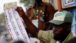 A National Youths Service Corp member counts ballot papers after voting closed at a polling station in Kano State, Nigeria February 23, 2019.
