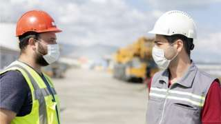 Construction workers in masks