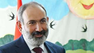 Nikol Pashinyan casts his vote at a polling station during the snap parliamentary election in Yerevan, Armenia, on 20 June 2021