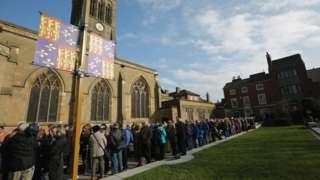 People queue to view Richard III's coffin