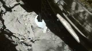 Spacecraft landing on rock surface