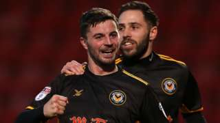 Padraig Amond celebrates his goal for Newport against Cheltenham