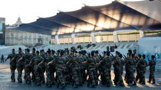 Soldiers march at a military base in Paris
