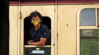 boy on train wearing mask