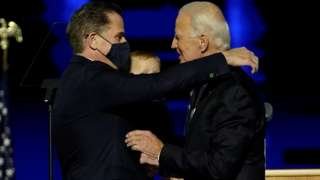 Joe Biden embraces his son Hunter Biden at an election rally, after the news media announced that Biden has won the 2020 U.S. presidential election over President Donald Trump, in Wilmington, Delaware, U.S., November 7, 2020.