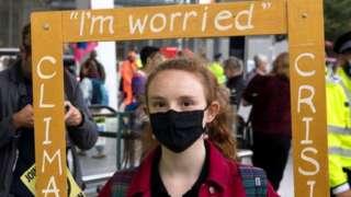 Environmental activists from Extinction Rebellion assemble outside London Bridge station