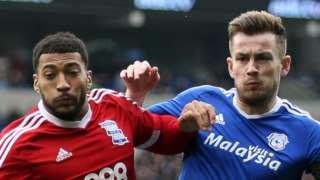 David Davis of Birmingham City is challenged by Cardiff's Joe Ralls